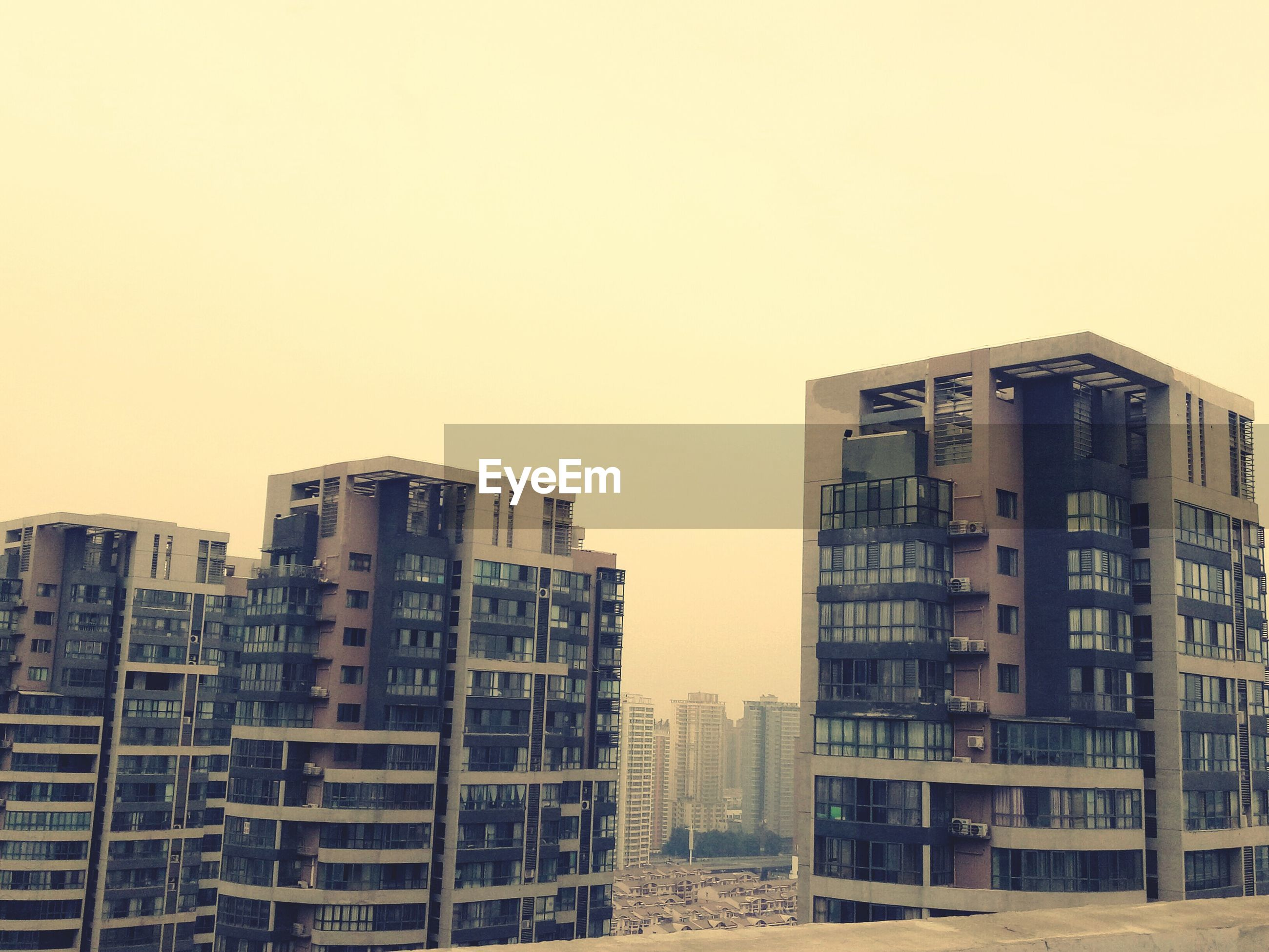 clear sky, architecture, sunset, building exterior, city, no people, residential, outdoors, sky, day