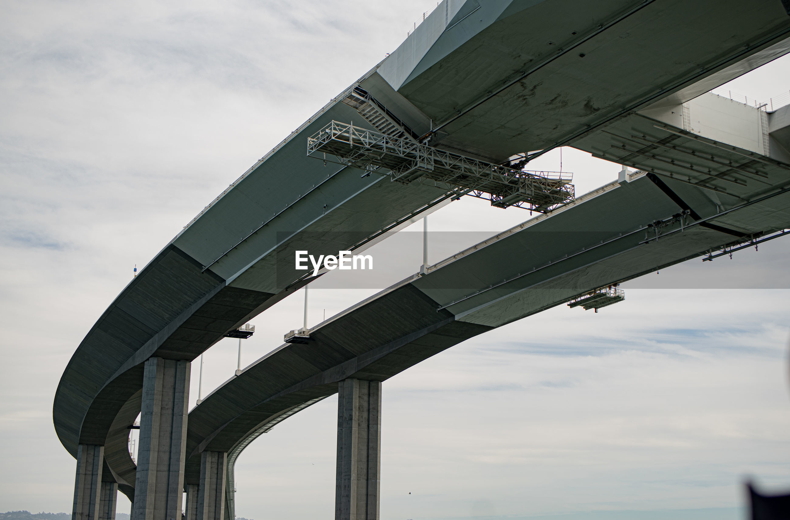 LOW ANGLE VIEW OF ELEVATED BRIDGE AGAINST SKY