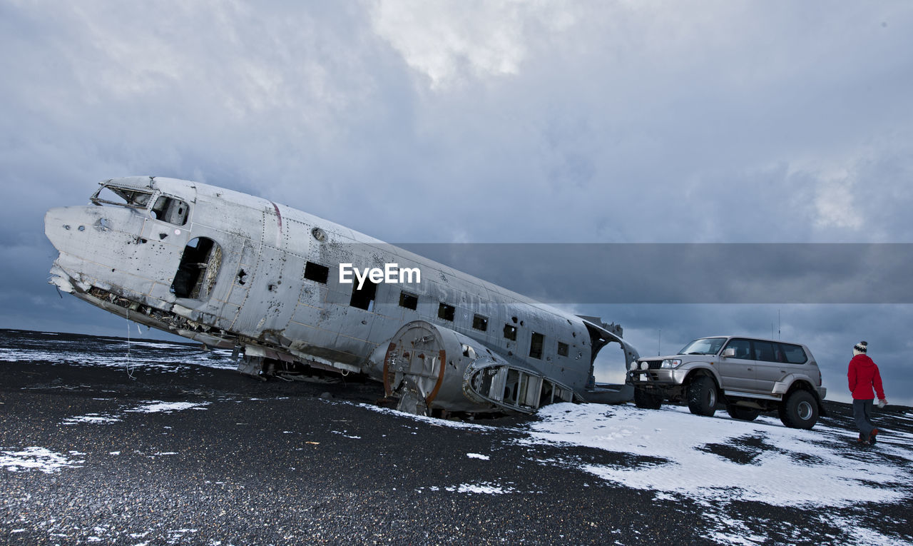 ABANDONED AIRPLANE ON SNOWY LAND