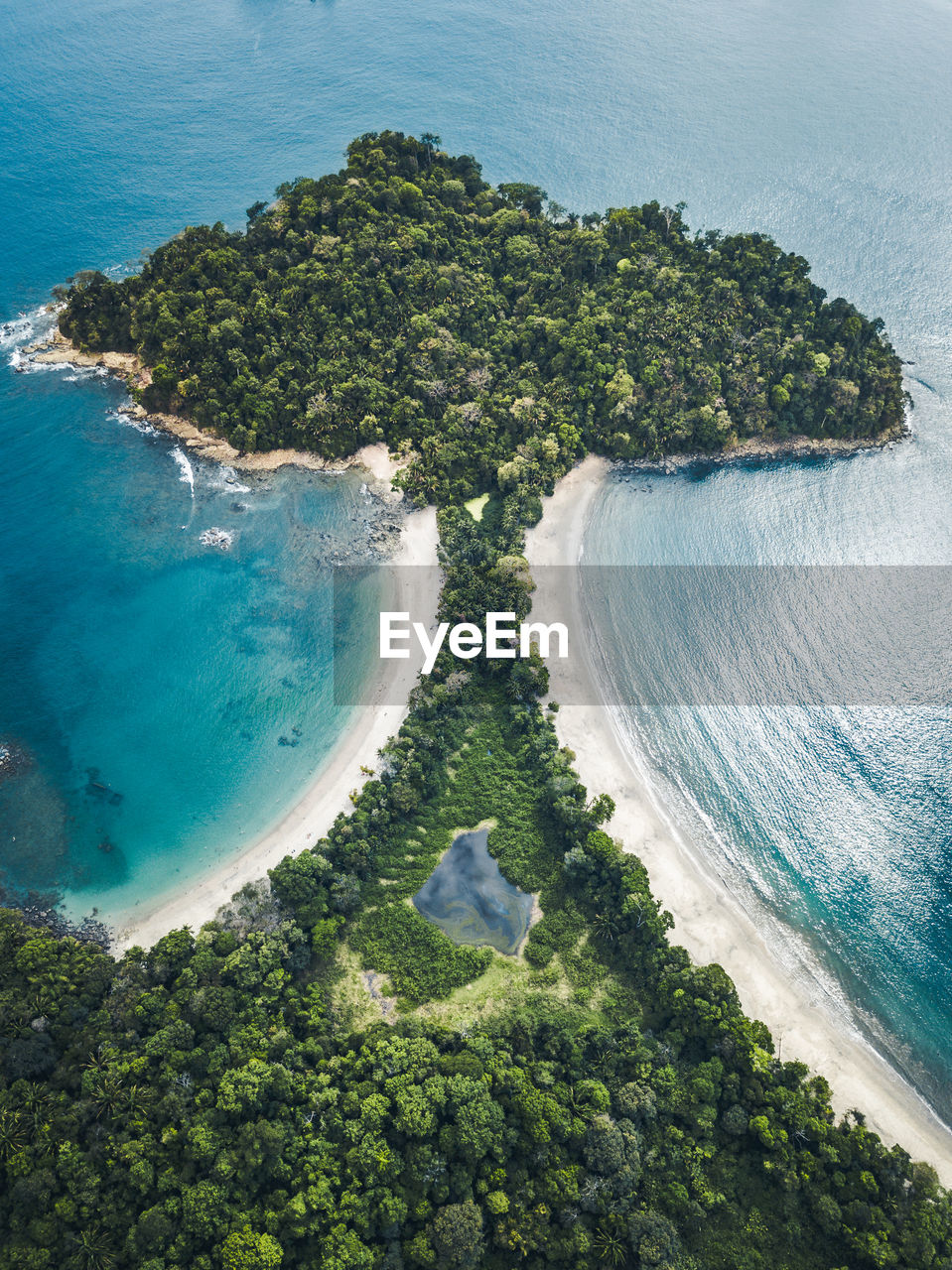 Aerial view of island amidst sea