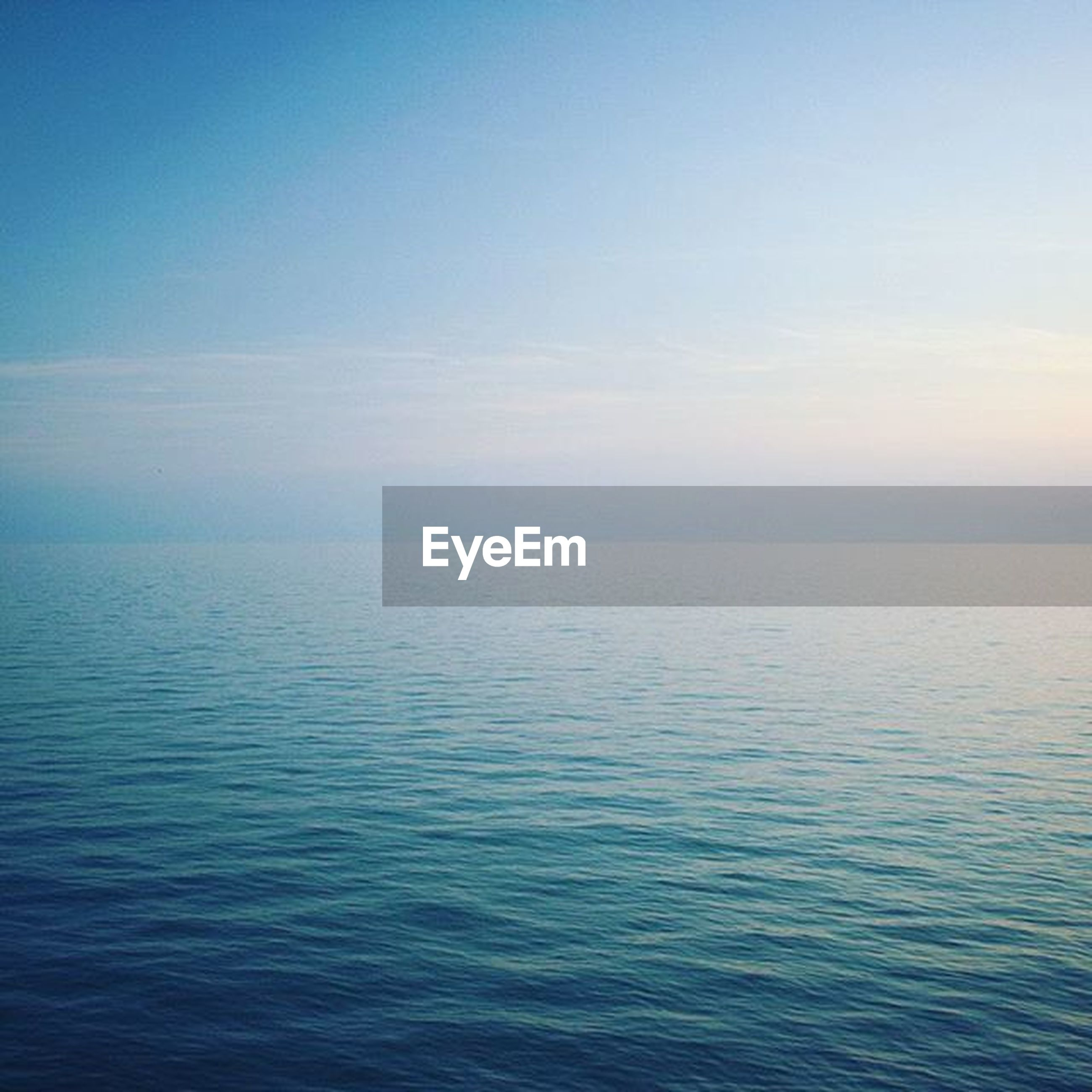 sea, water, tranquil scene, scenics, tranquility, beauty in nature, waterfront, horizon over water, sky, nature, blue, rippled, idyllic, seascape, copy space, calm, outdoors, remote, no people, ocean