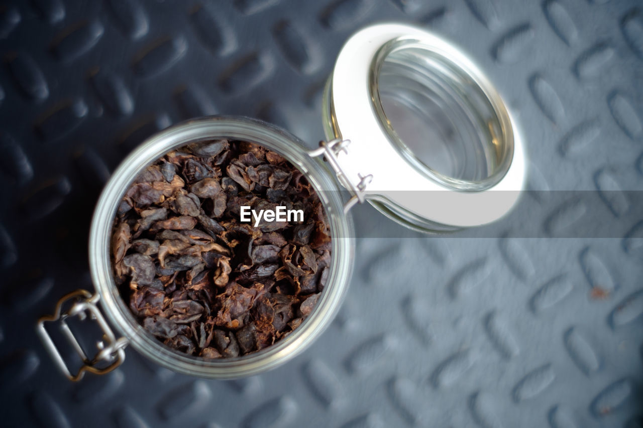 High angle view of coffee in jar on table