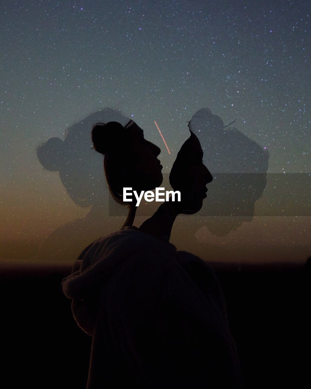 Multiple Image Of Silhouette Woman Against Star Field At Night