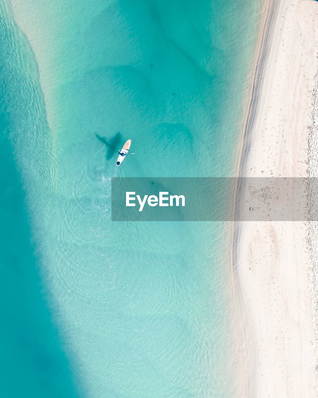 Aerial view of person sailing in sea