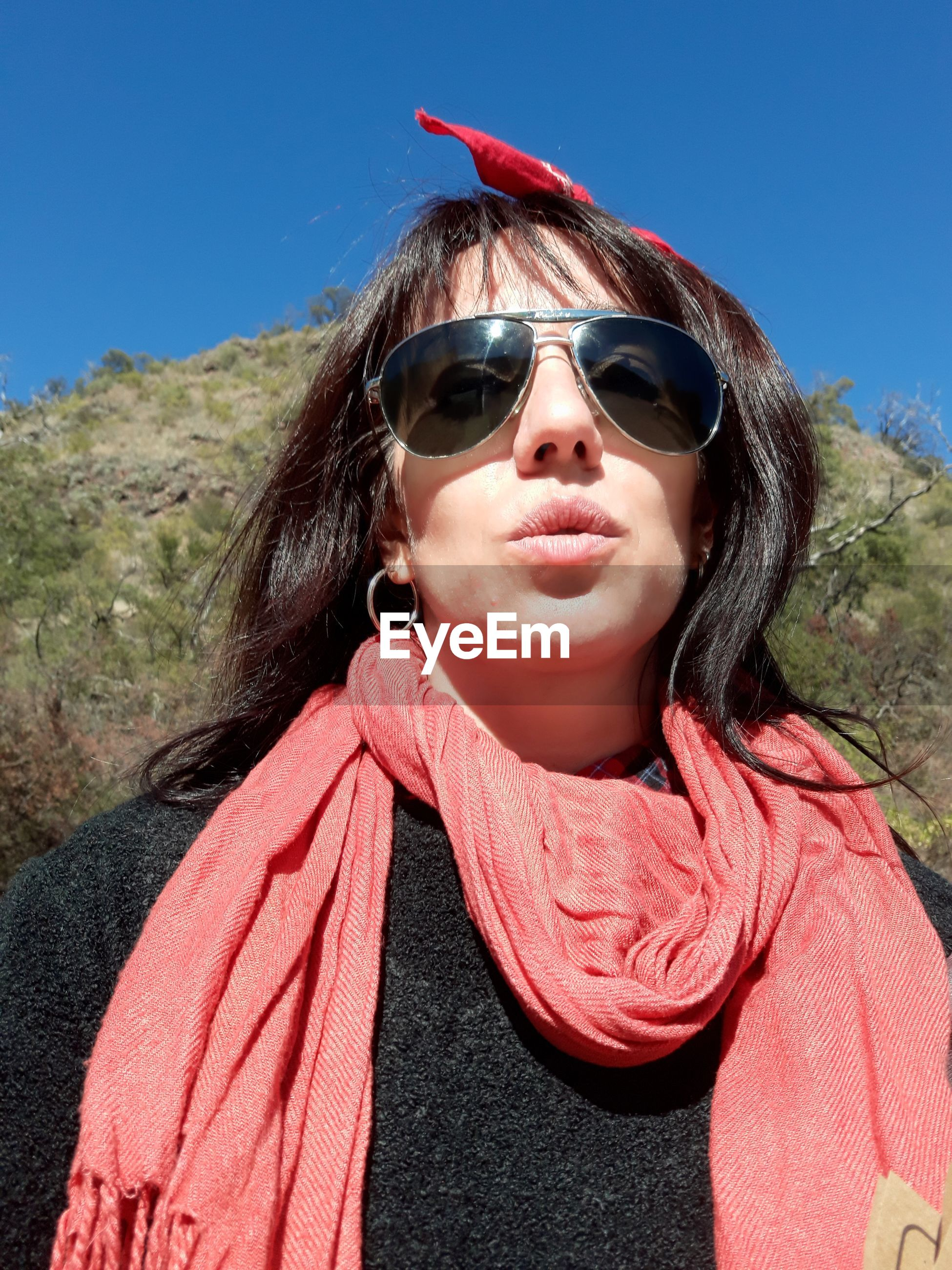 Portrait of woman wearing sunglasses during sunny day