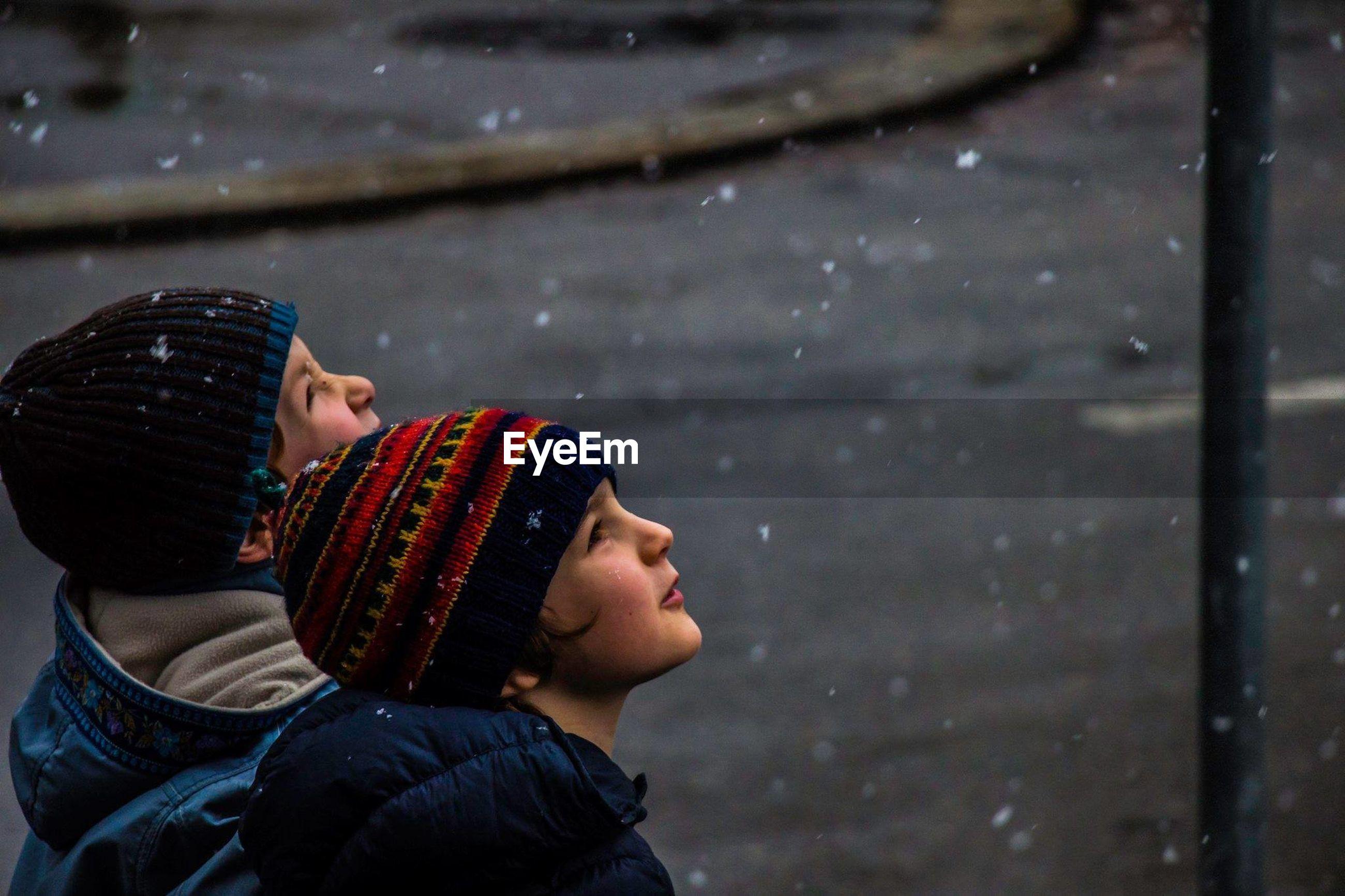 Boys looking at snow