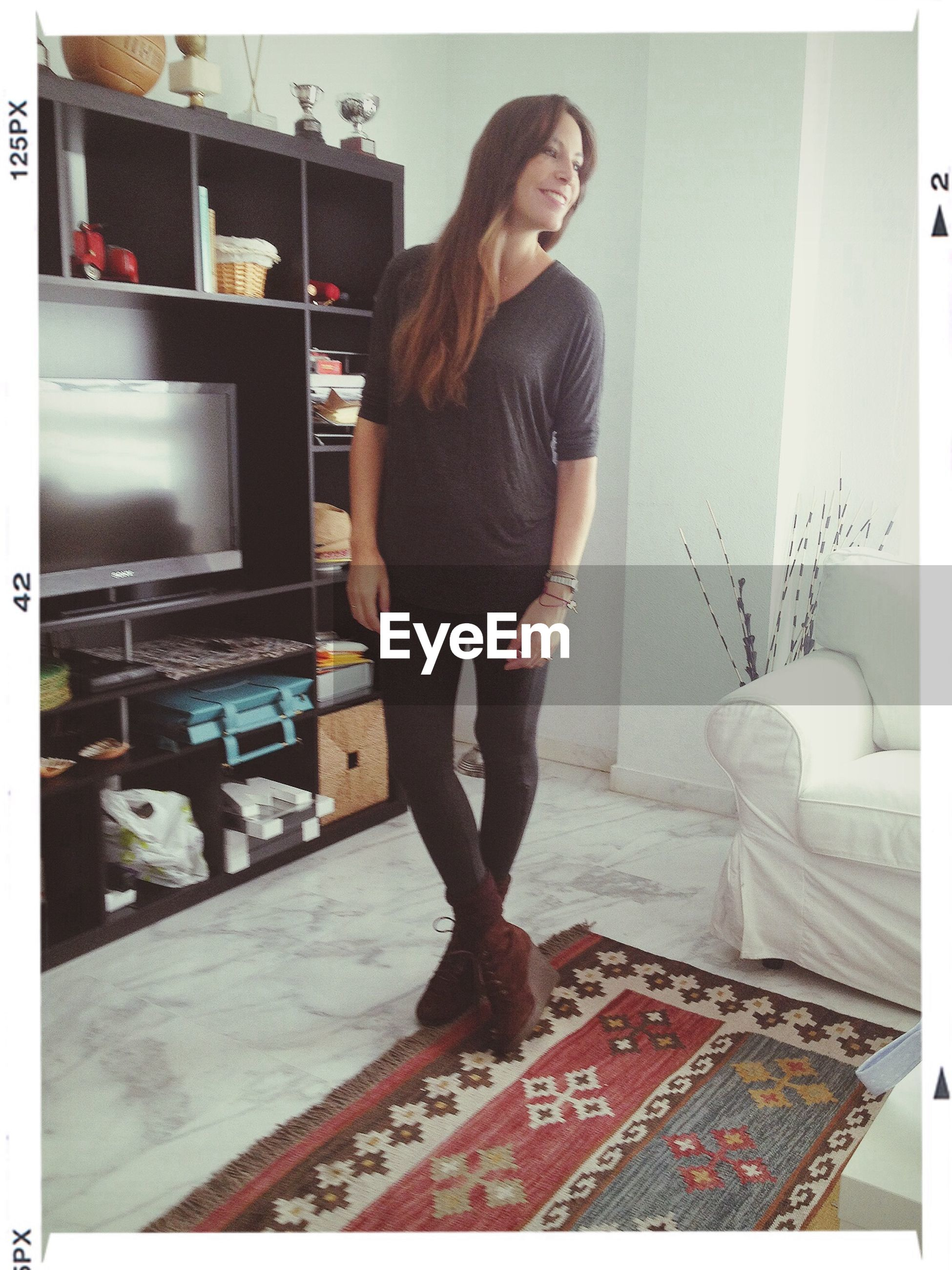 young adult, transfer print, indoors, young women, lifestyles, casual clothing, auto post production filter, person, full length, front view, standing, leisure activity, portrait, looking at camera, architecture, built structure, three quarter length