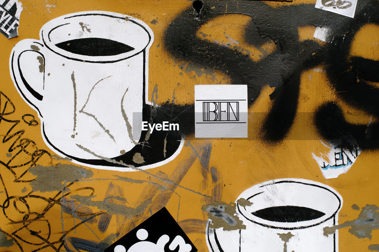 graffiti, creativity, art and craft, no people, yellow, wall - building feature, paint, communication, text, close-up, day, metal, indoors, messy, black color, sign, abandoned, pattern