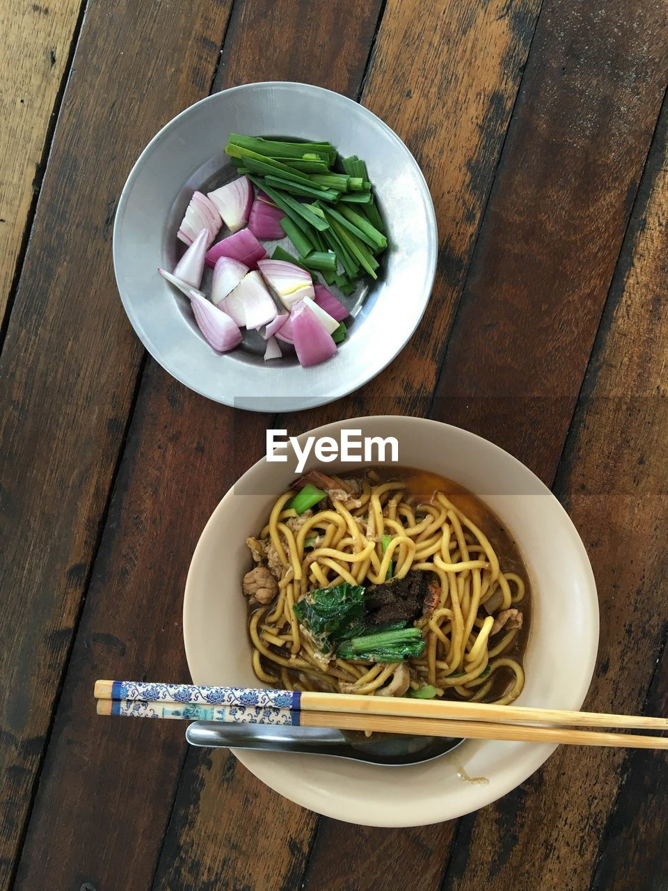 Noodle soup in bowl on table