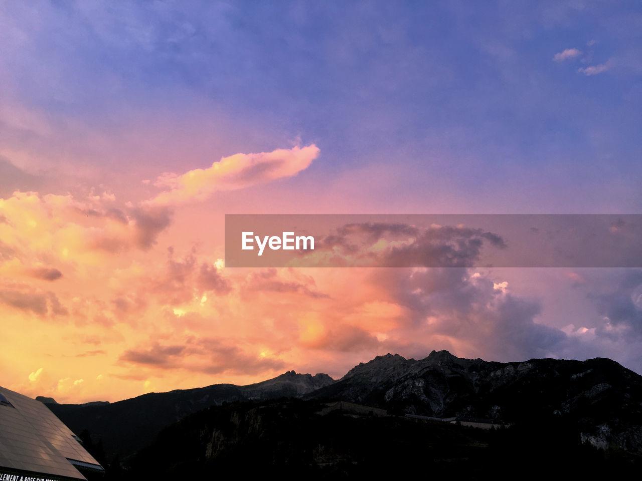 sky, mountain, sunset, cloud - sky, beauty in nature, scenics - nature, nature, environment, no people, tranquility, tranquil scene, mountain range, orange color, landscape, outdoors, idyllic, mountain peak, scenery, silhouette, non-urban scene, high, range