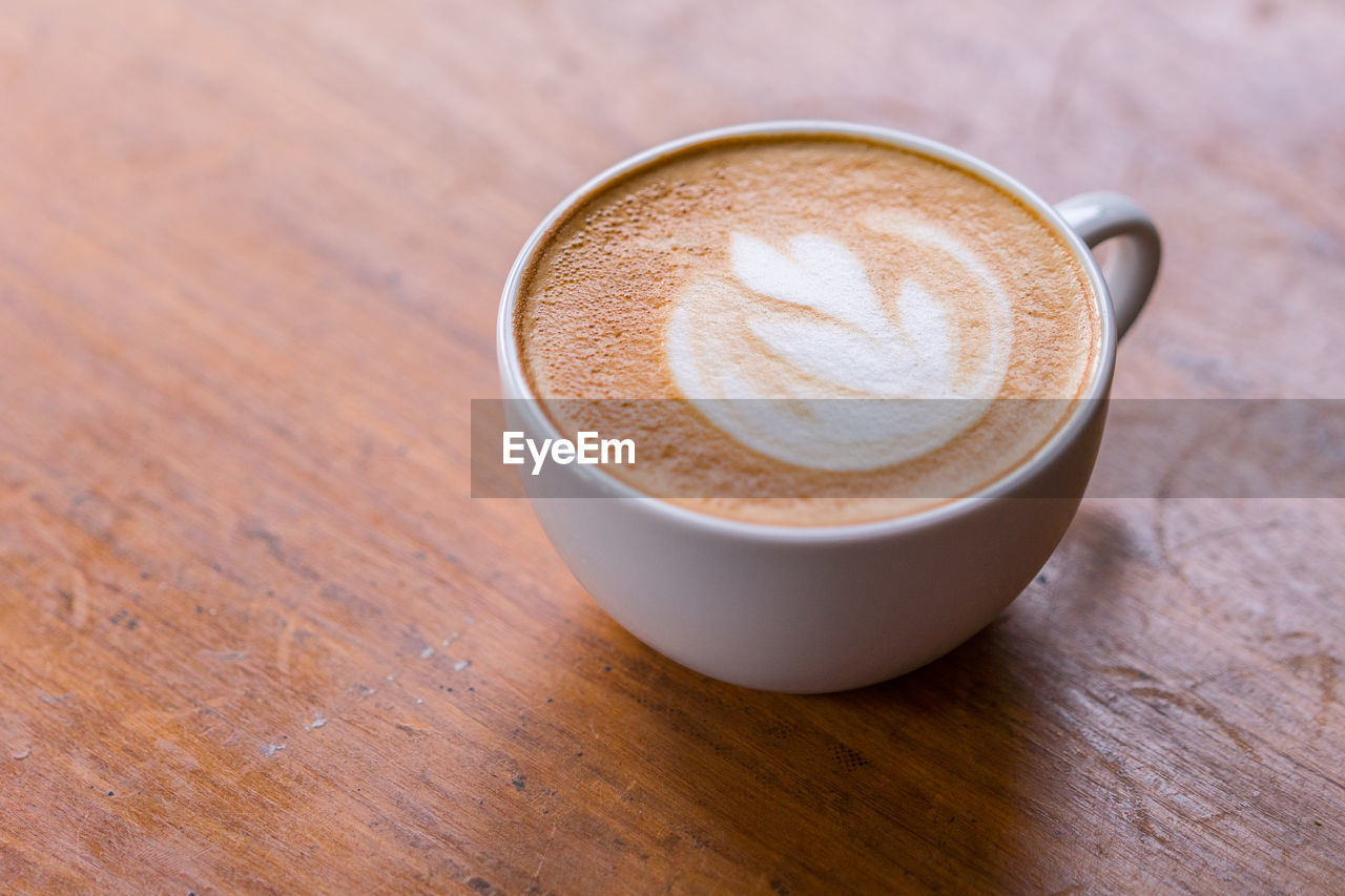 refreshment, drink, coffee cup, coffee - drink, coffee, food and drink, mug, cup, frothy drink, still life, hot drink, table, cappuccino, froth art, close-up, freshness, wood - material, high angle view, latte, indoors, no people, non-alcoholic beverage, crockery, froth