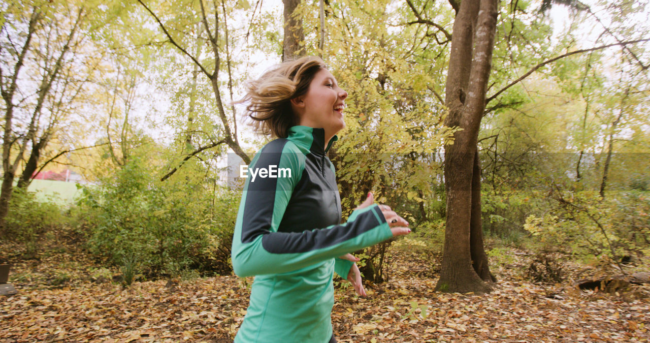 Young Woman Running In Forest