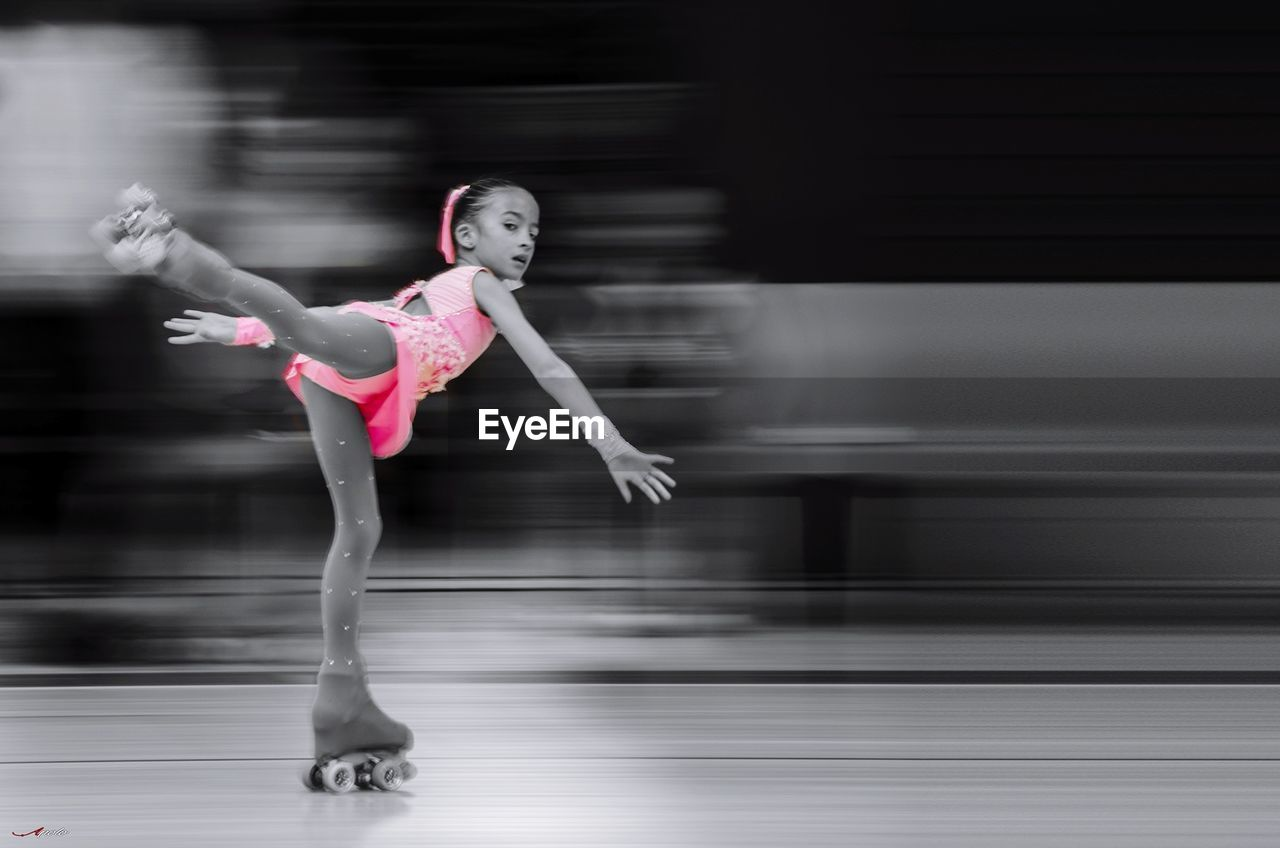 skill, ballet, ballet dancer, motion, blurred motion, dancing, balance, performance, real people, dancer, expertise, grace, one person, lifestyles, flexibility, ballet studio, practicing, full length, exercising, performing arts event, indoors, healthy lifestyle, stage costume, young women, young adult, day
