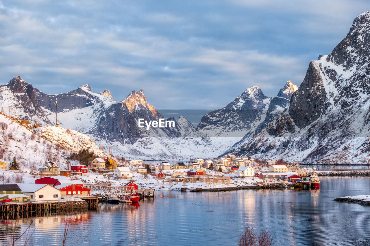 mountain, water, cold temperature, winter, beauty in nature, sky, cloud - sky, mountain range, scenics - nature, snow, nature, architecture, snowcapped mountain, no people, waterfront, nautical vessel, tranquility, tranquil scene