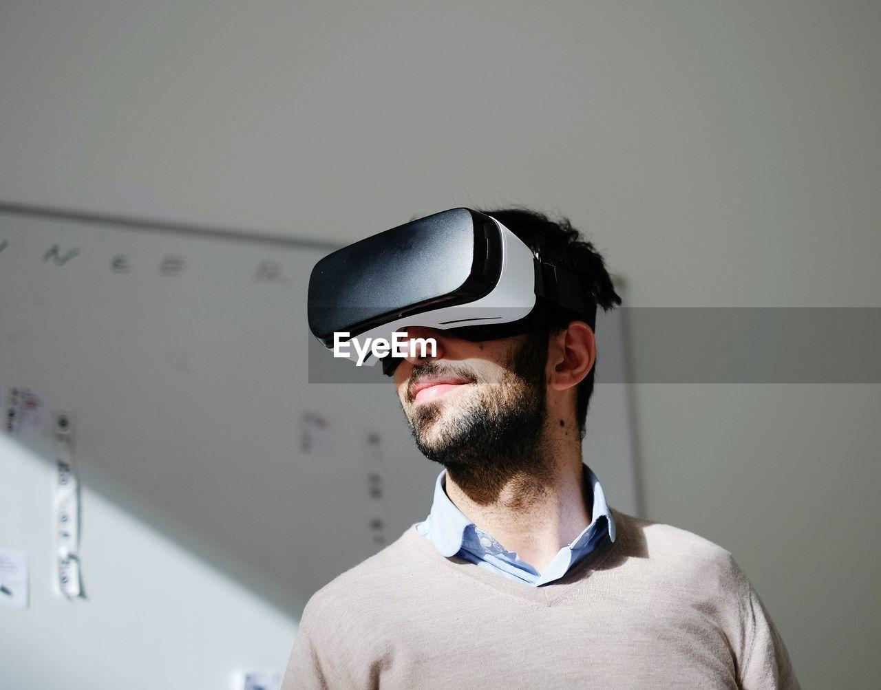 Portrait of man wearing virtual reality glasses