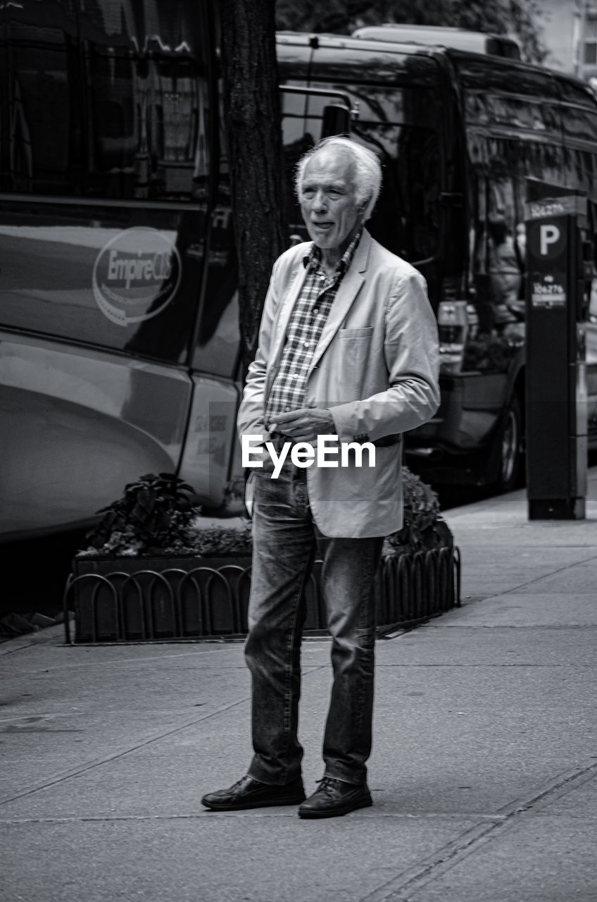 full length, standing, one person, senior adult, real people, lifestyles, casual clothing, transportation, front view, mode of transportation, portrait, adult, leisure activity, senior men, day, senior women, looking at camera, white hair, hairstyle