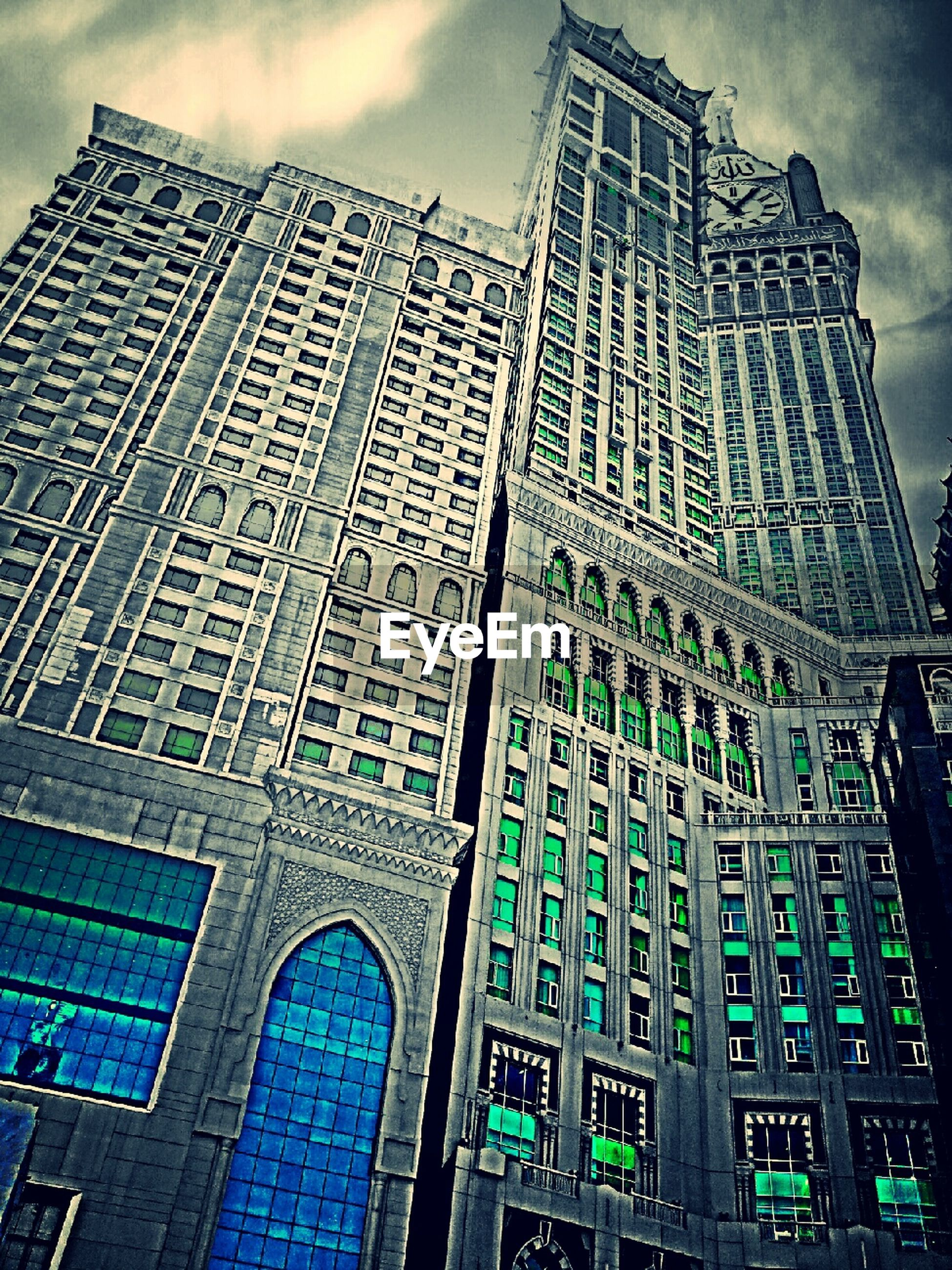 low angle view, architecture, building exterior, built structure, city, sky, tall - high, modern, tower, skyscraper, office building, building, capital cities, cloud - sky, day, glass - material, outdoors, window, travel destinations, no people