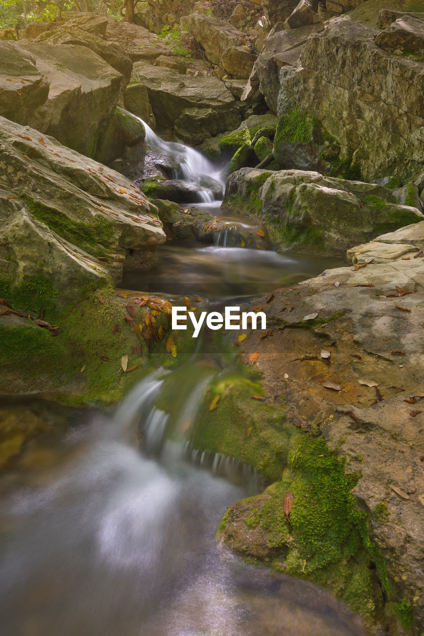 motion, long exposure, water, blurred motion, waterfall, scenics - nature, rock, beauty in nature, flowing water, rock - object, solid, nature, no people, forest, environment, land, day, moss, plant, flowing, outdoors, stream - flowing water, power in nature, falling water, rainforest