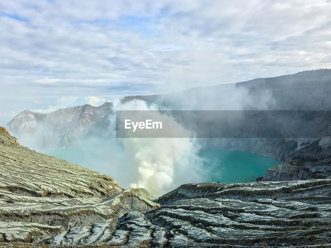 scenics - nature, geology, beauty in nature, mountain, physical geography, non-urban scene, volcano, smoke - physical structure, power in nature, heat - temperature, tranquil scene, sky, cloud - sky, nature, no people, erupting, steam, environment, day, active volcano, outdoors, volcanic crater, hot spring