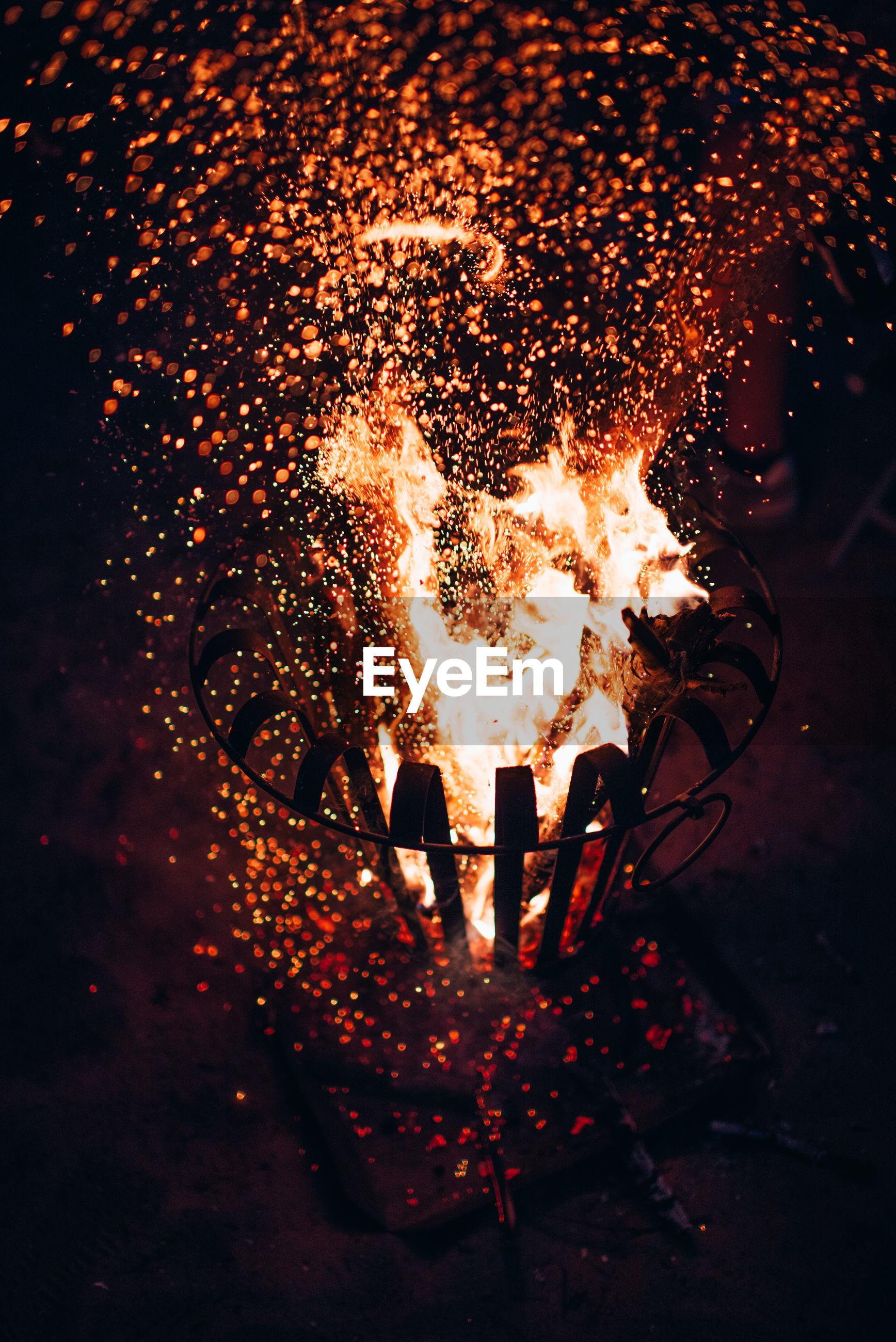 View of bonfire at night
