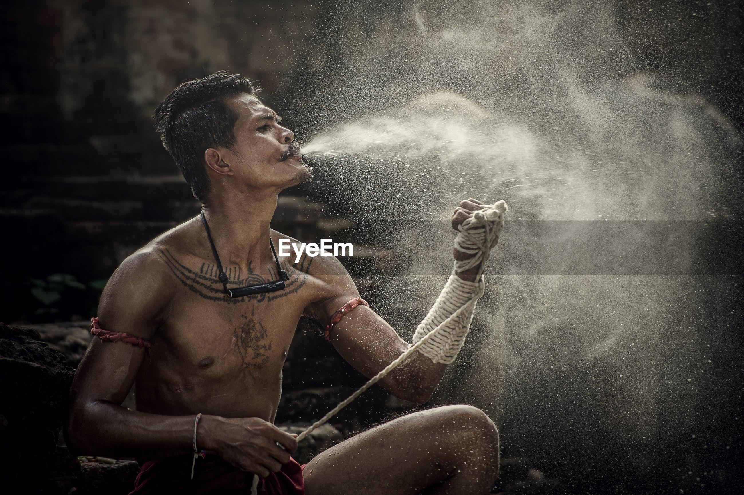 Man spraying water on hand