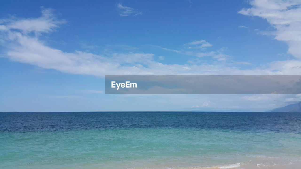 sea, sky, water, beauty in nature, horizon, horizon over water, cloud - sky, scenics - nature, tranquility, tranquil scene, blue, land, day, nature, no people, idyllic, beach, outdoors, waterfront