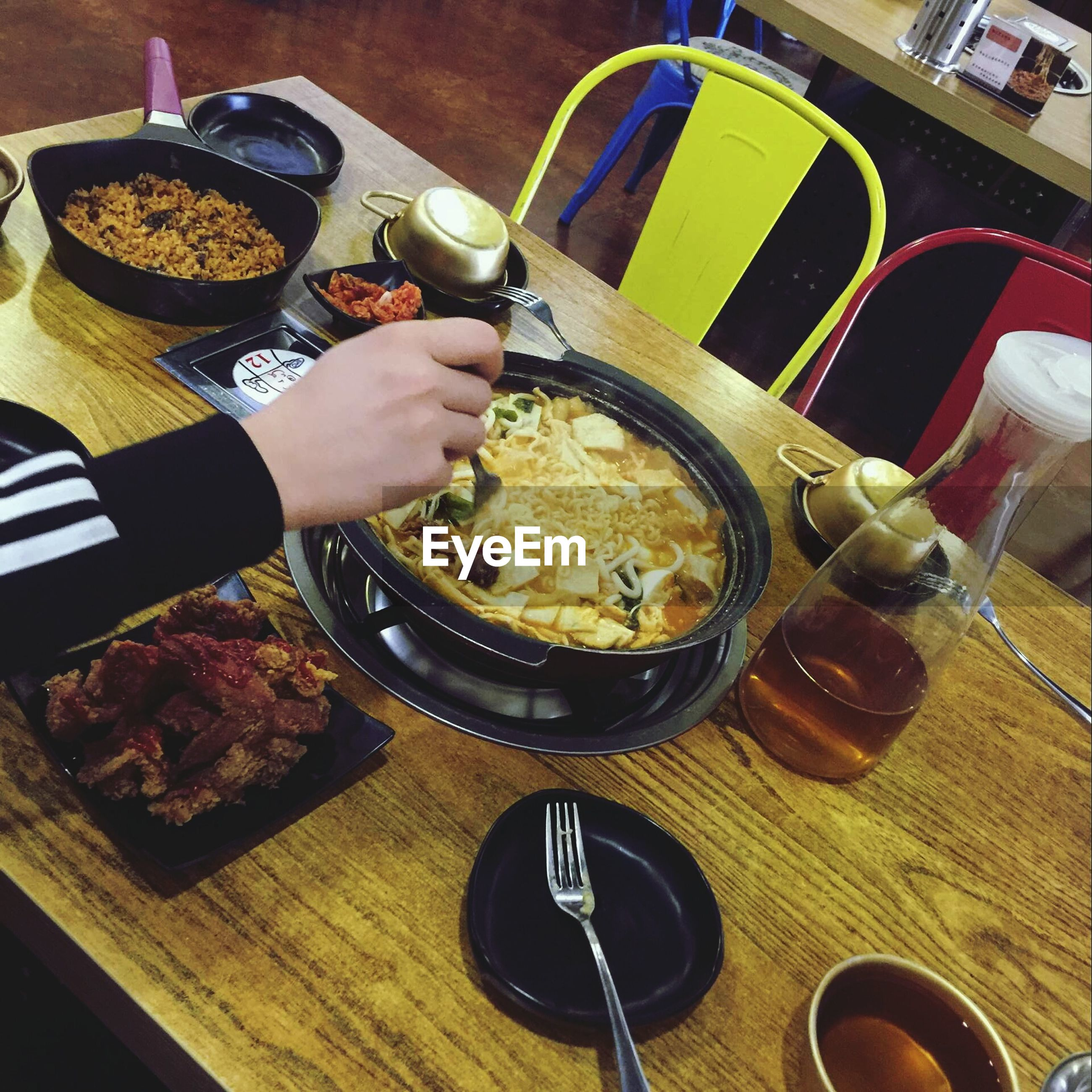 food, food and drink, real people, plate, indoors, one person, lifestyles, table, holding, freshness, drink, ready-to-eat, refreshment, eating, human body part, human hand, temptation, healthy eating, adults only, people, day, adult