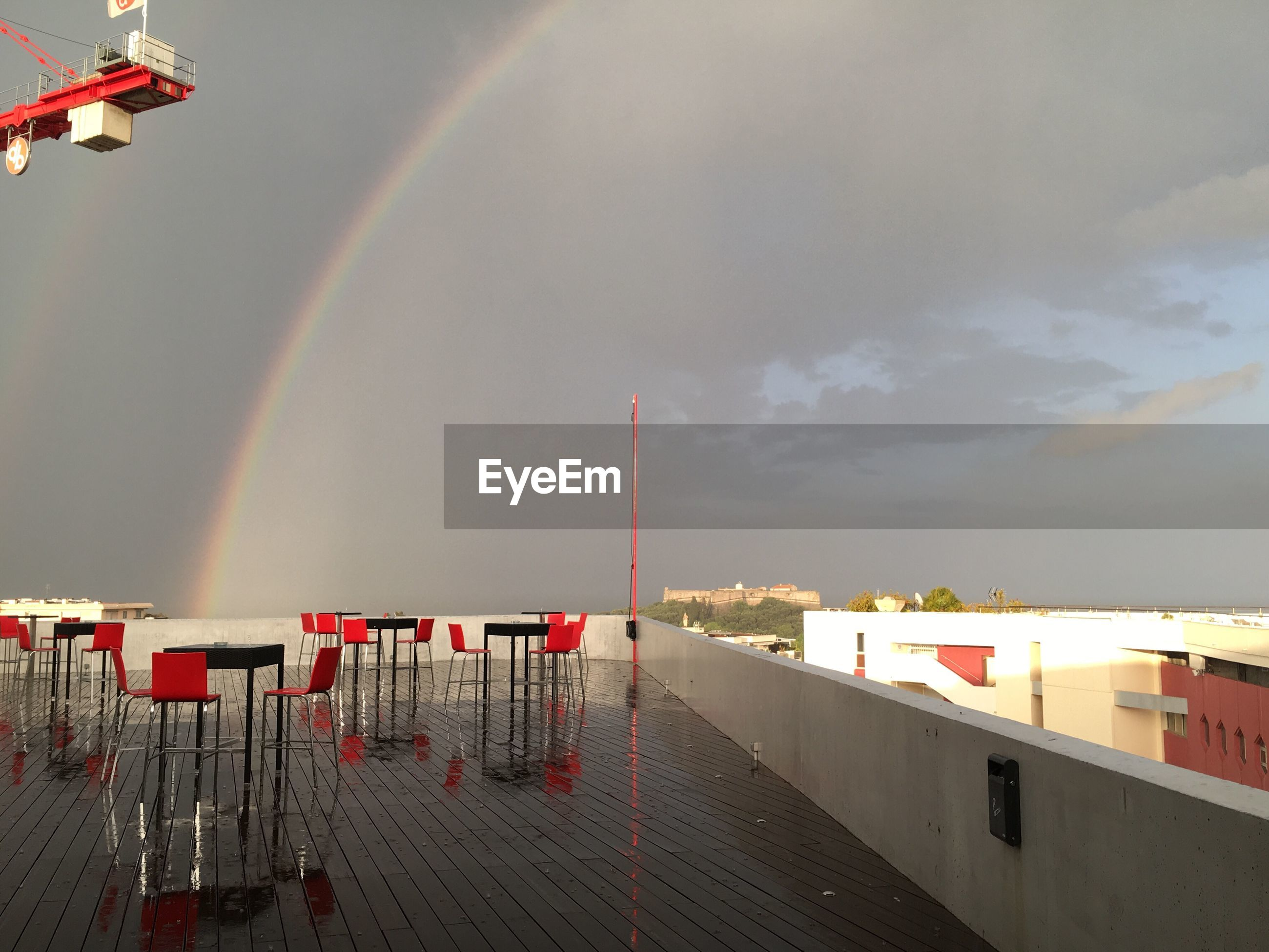 SCENIC VIEW OF RAINBOW OVER PIER