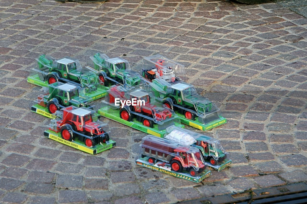 toy, childhood, high angle view, day, no people, outdoors, toy car, model - object, architecture, tire