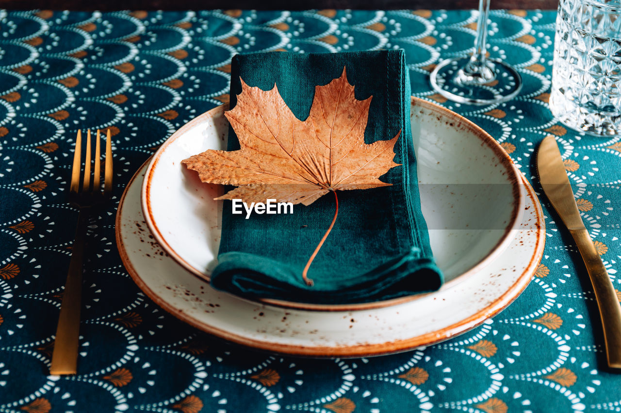 High angle view of dry leaves on table