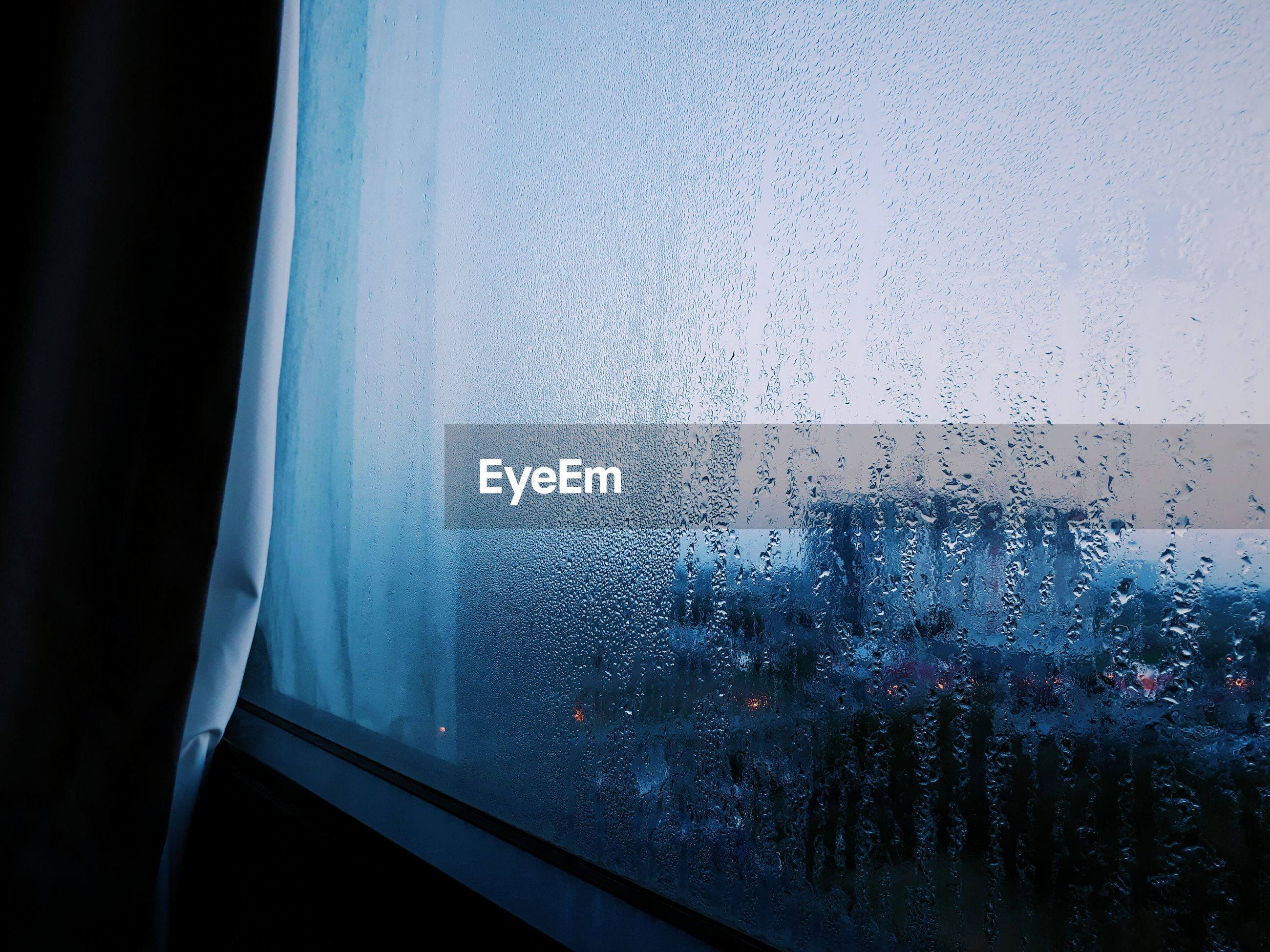 Close-up of wet window during monsoon