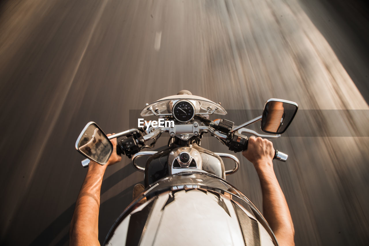 High angle view of man riding motorcycle on road