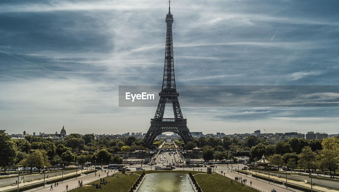 Eiffel tower amidst trees against sky