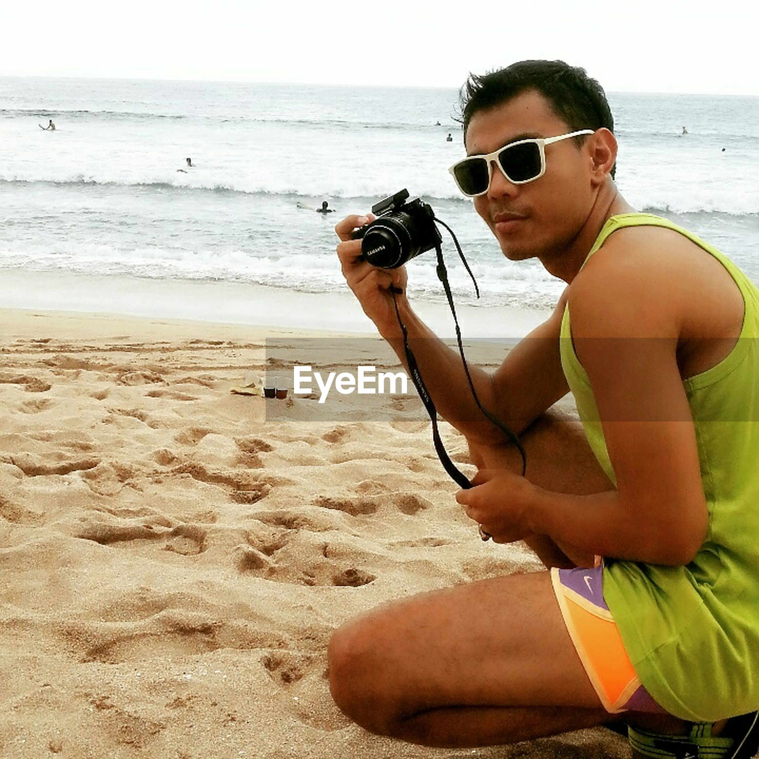 beach, sea, person, young adult, shore, lifestyles, leisure activity, sand, water, horizon over water, sunglasses, vacations, young women, full length, portrait, shirtless, looking at camera, enjoyment