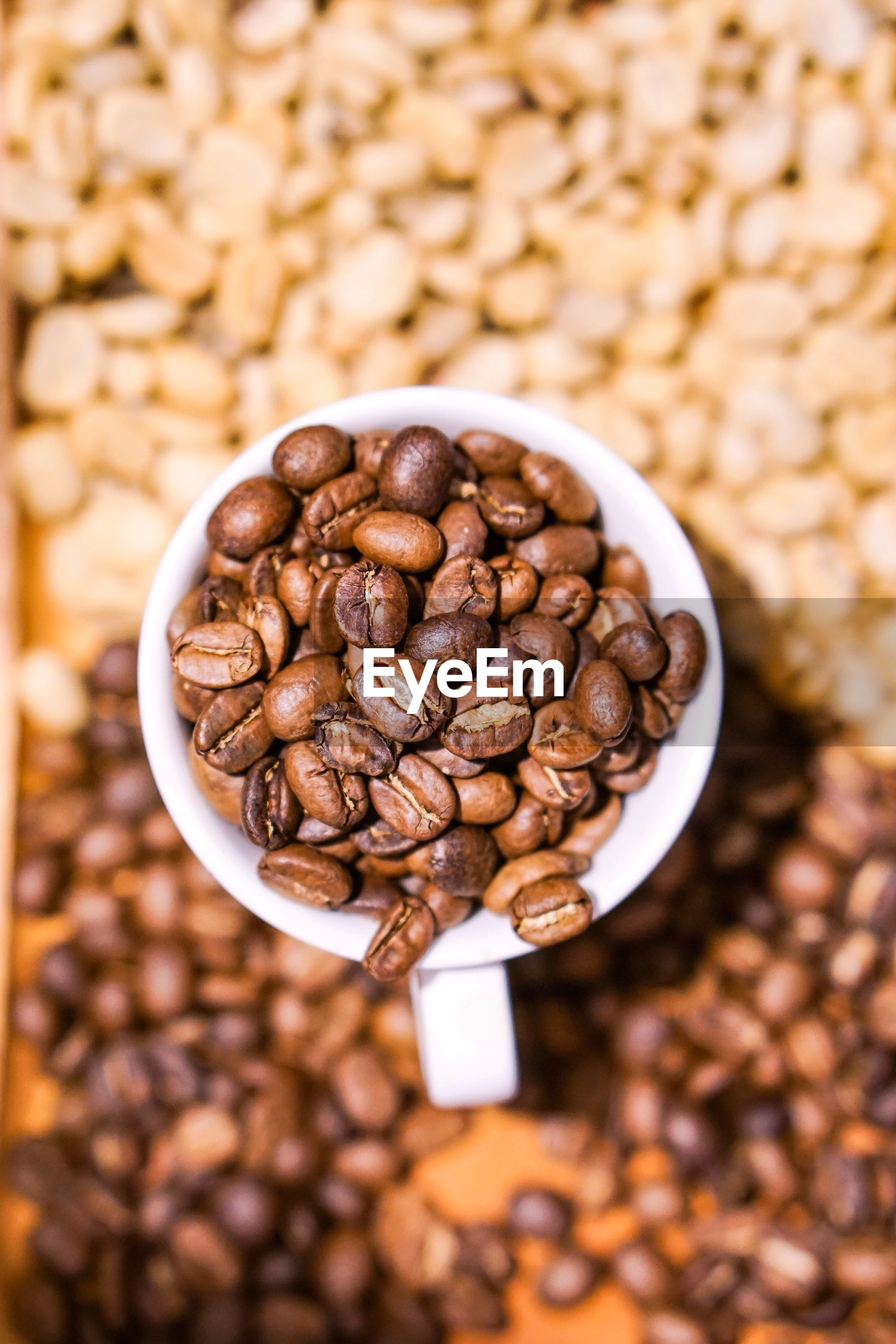 CLOSE-UP OF COFFEE BEANS IN CUP