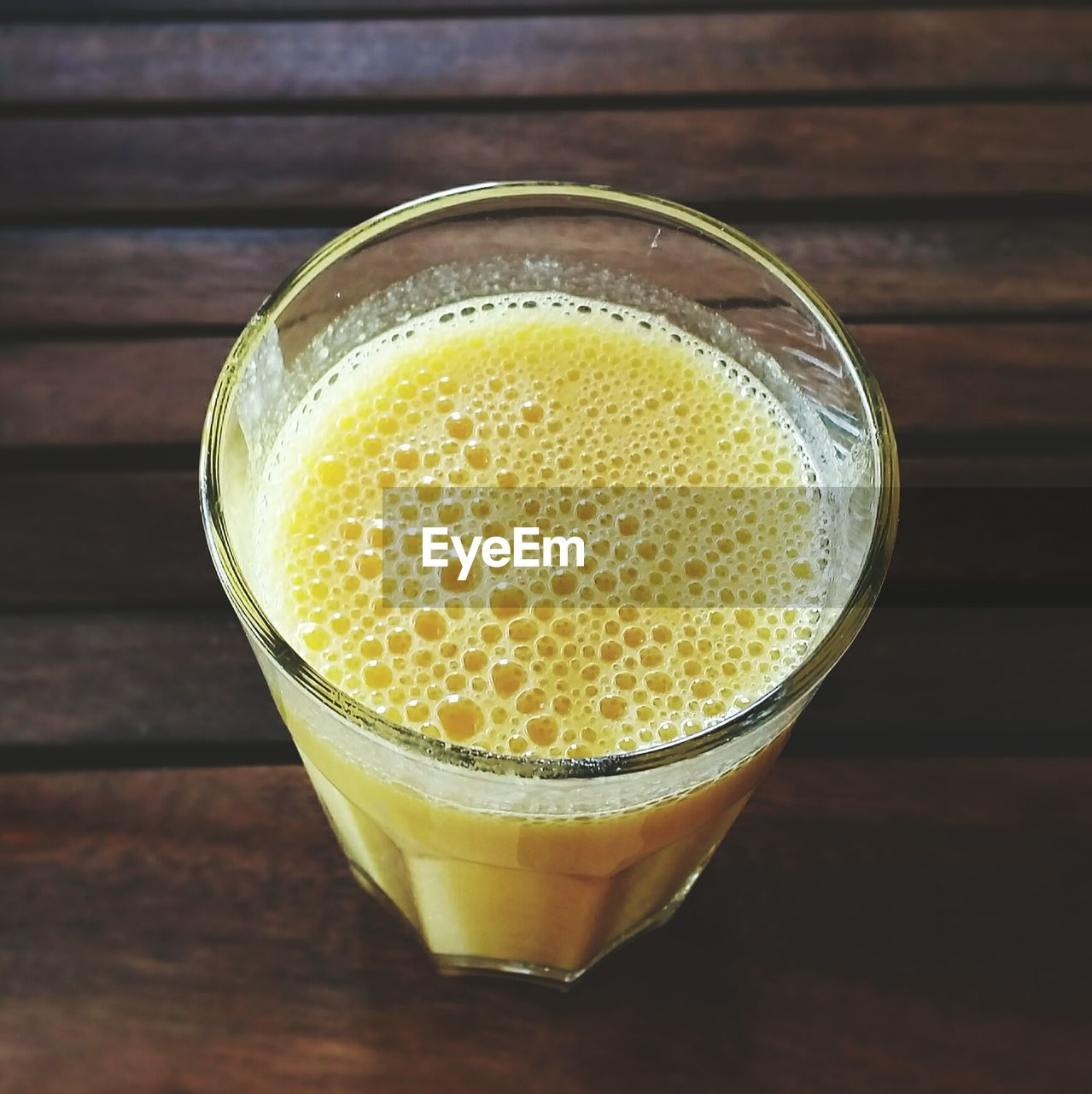 Close-Up Of Served Mango Juice In Glass