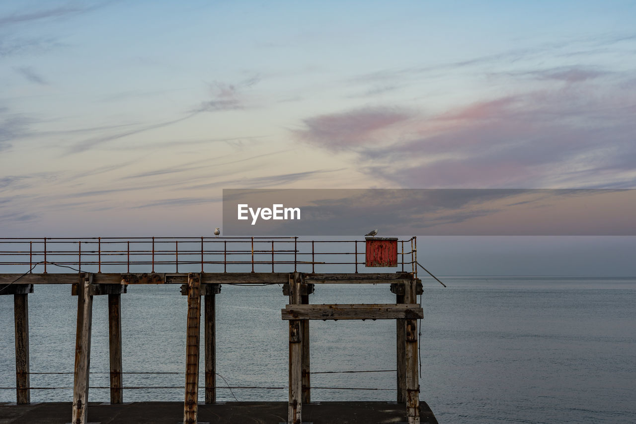sky, sea, water, sunset, architecture, beauty in nature, built structure, cloud - sky, scenics - nature, tranquility, tranquil scene, nature, no people, railing, horizon over water, horizon, pier, idyllic, outdoors
