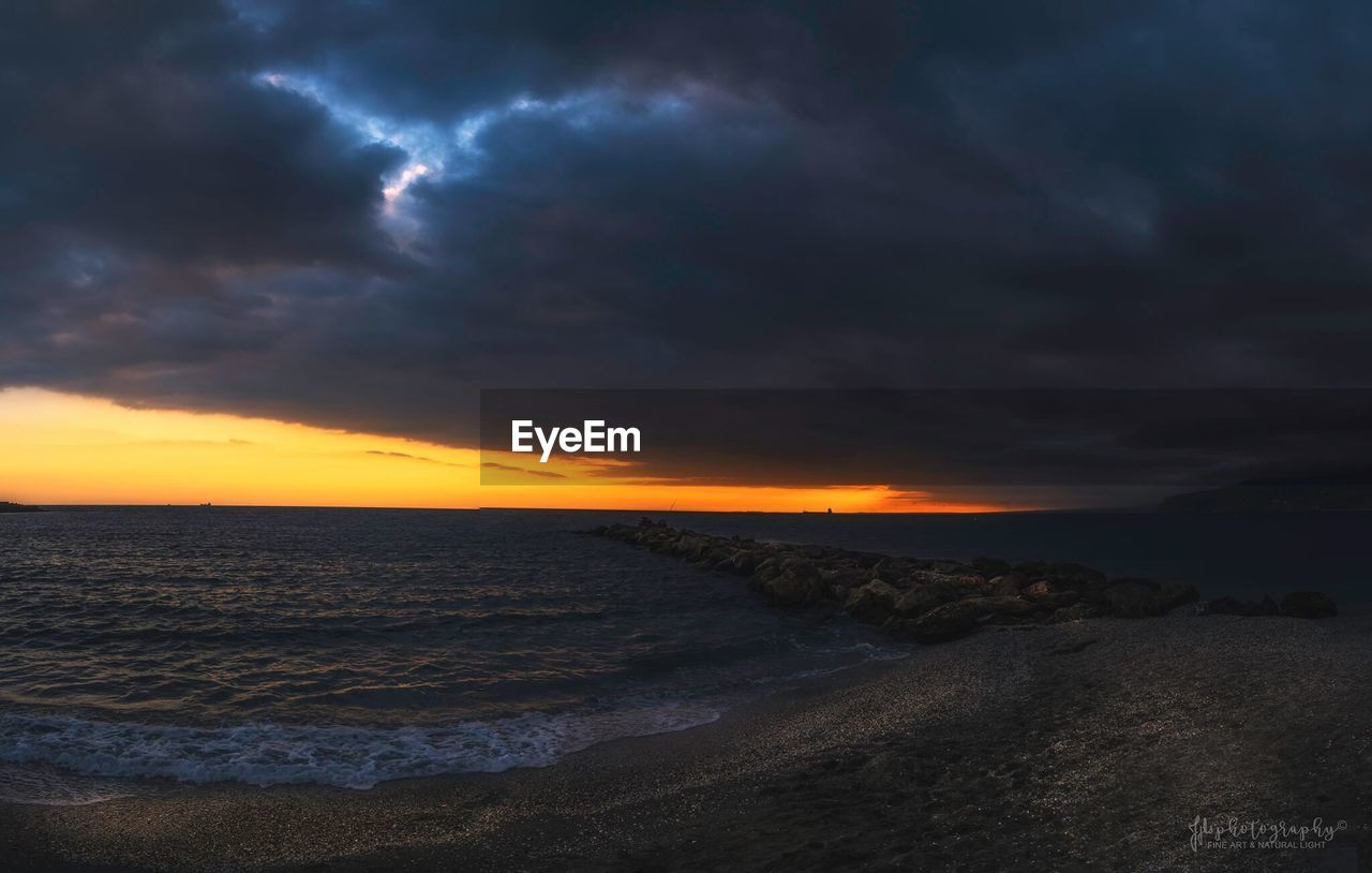 sea, beach, nature, sunset, scenics, beauty in nature, tranquility, tranquil scene, water, sand, sky, horizon over water, no people, cloud - sky, outdoors, wave, day