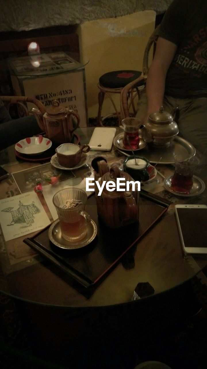 food and drink, indoors, table, refreshment, plate, drink, real people, freshness, one person, tea - hot drink, food, human hand, close-up, day, people
