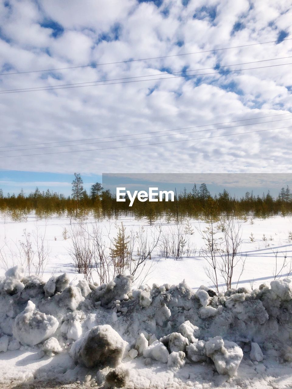 sky, cloud - sky, snow, winter, scenics - nature, beauty in nature, cold temperature, nature, tree, environment, non-urban scene, tranquility, no people, landscape, land, tranquil scene, plant, day, white color, power in nature, pollution