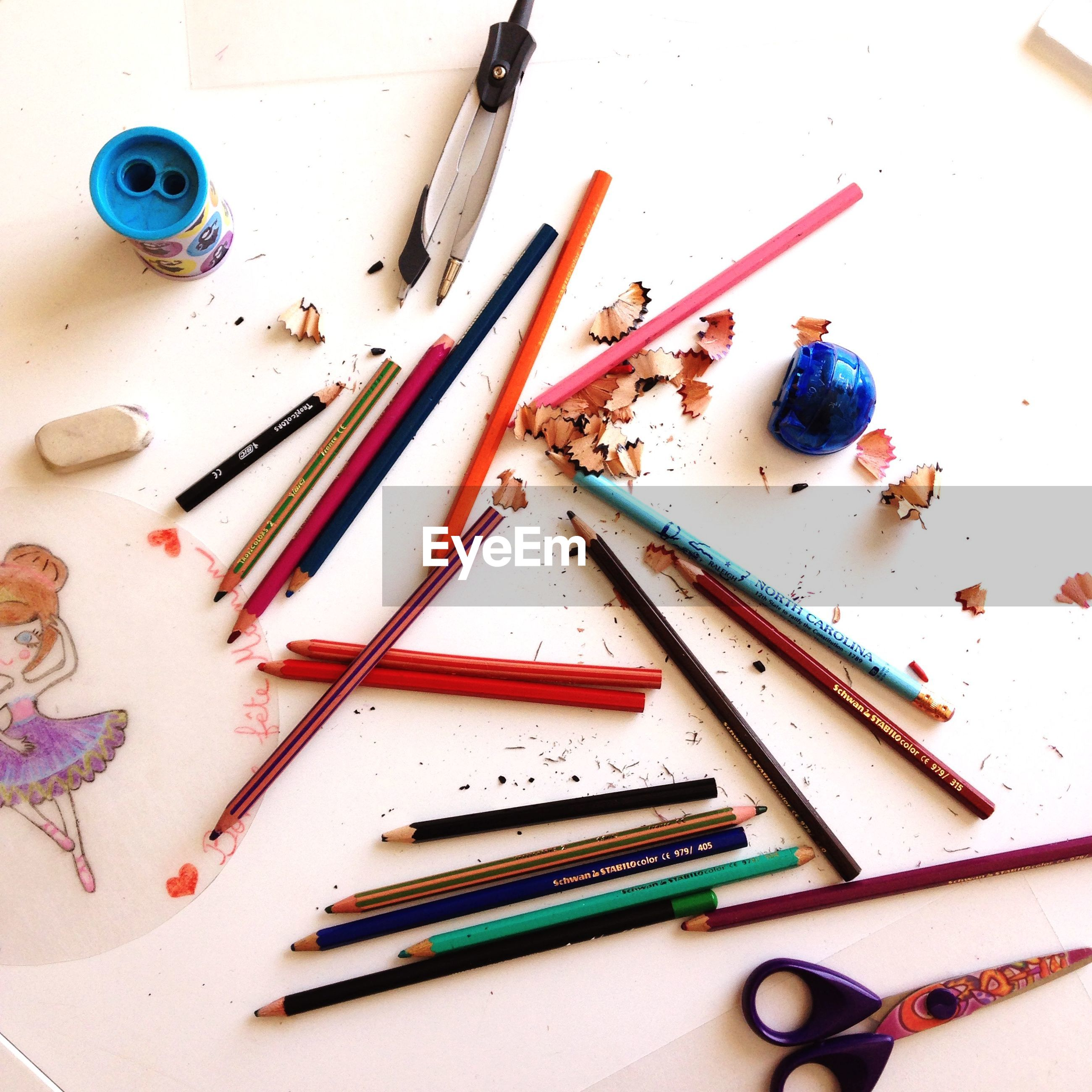 indoors, still life, variation, large group of objects, multi colored, close-up, table, high angle view, pencil, choice, directly above, art and craft, colored pencil, studio shot, medium group of objects, arrangement, wood - material, group of objects, abundance, fork