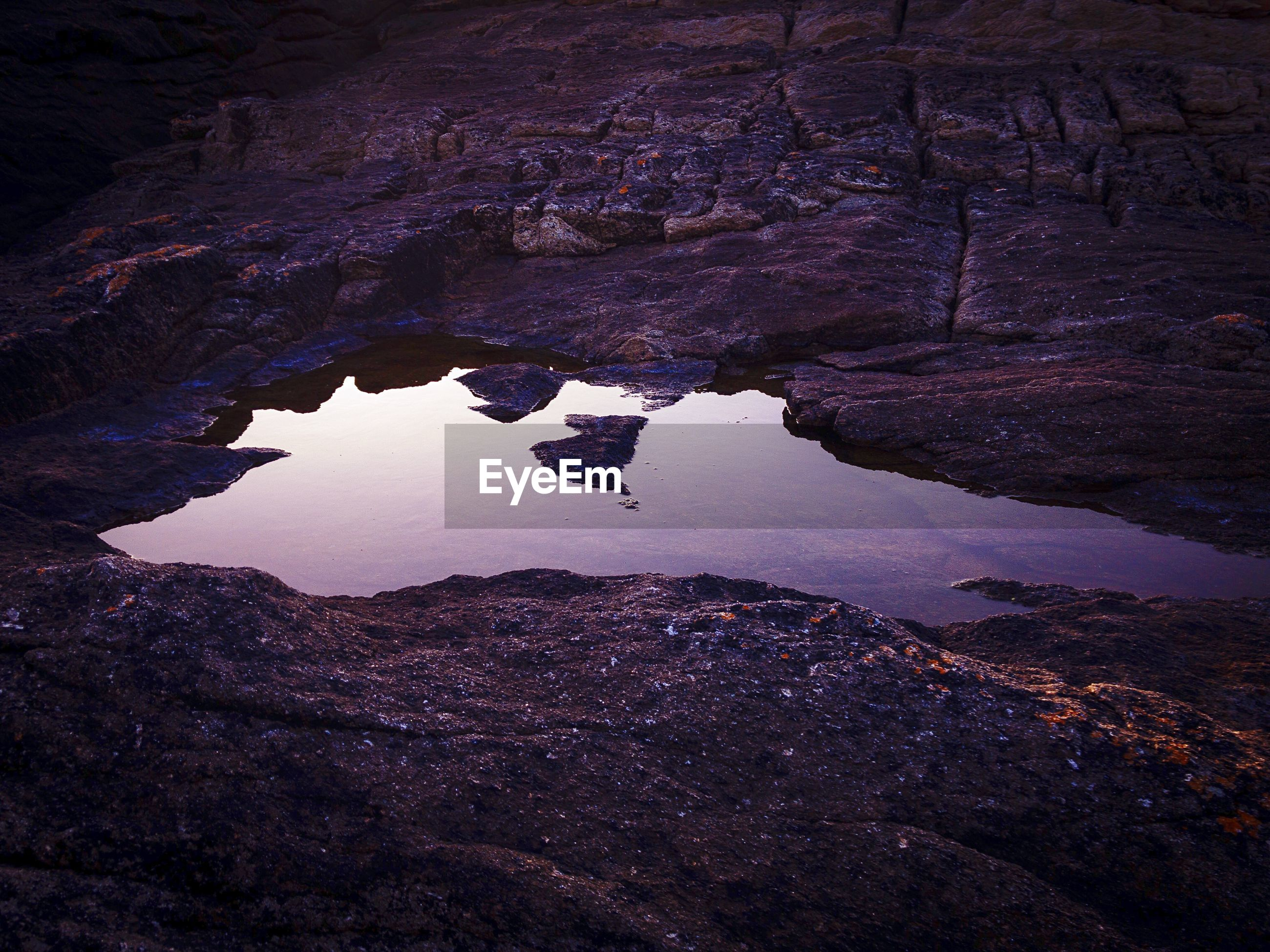 rock, rock - object, water, solid, rock formation, nature, tranquility, beauty in nature, no people, scenics - nature, tranquil scene, high angle view, physical geography, non-urban scene, geology, day, lake, outdoors, eroded, formation
