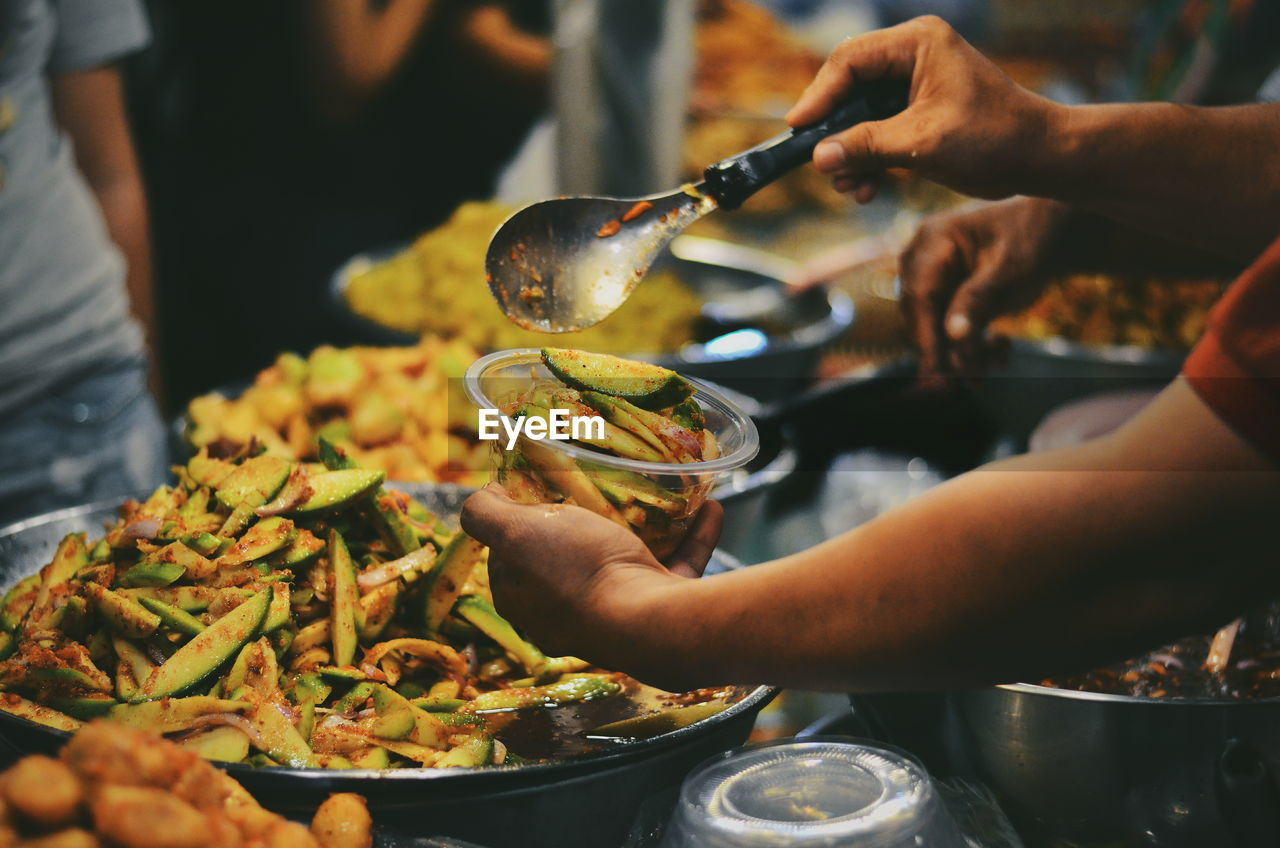 food and drink, food, human hand, hand, real people, one person, freshness, holding, human body part, healthy eating, lifestyles, ready-to-eat, indoors, unrecognizable person, wellbeing, plate, close-up, business, kitchen utensil, preparation, finger, preparing food