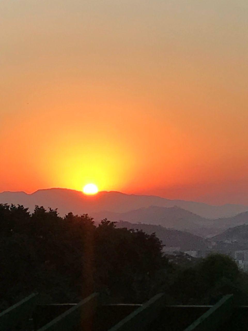 sunset, sky, beauty in nature, scenics - nature, orange color, sun, mountain, plant, landscape, tree, tranquil scene, environment, tranquility, no people, nature, mountain range, idyllic, non-urban scene, copy space, sunlight, outdoors, romantic sky