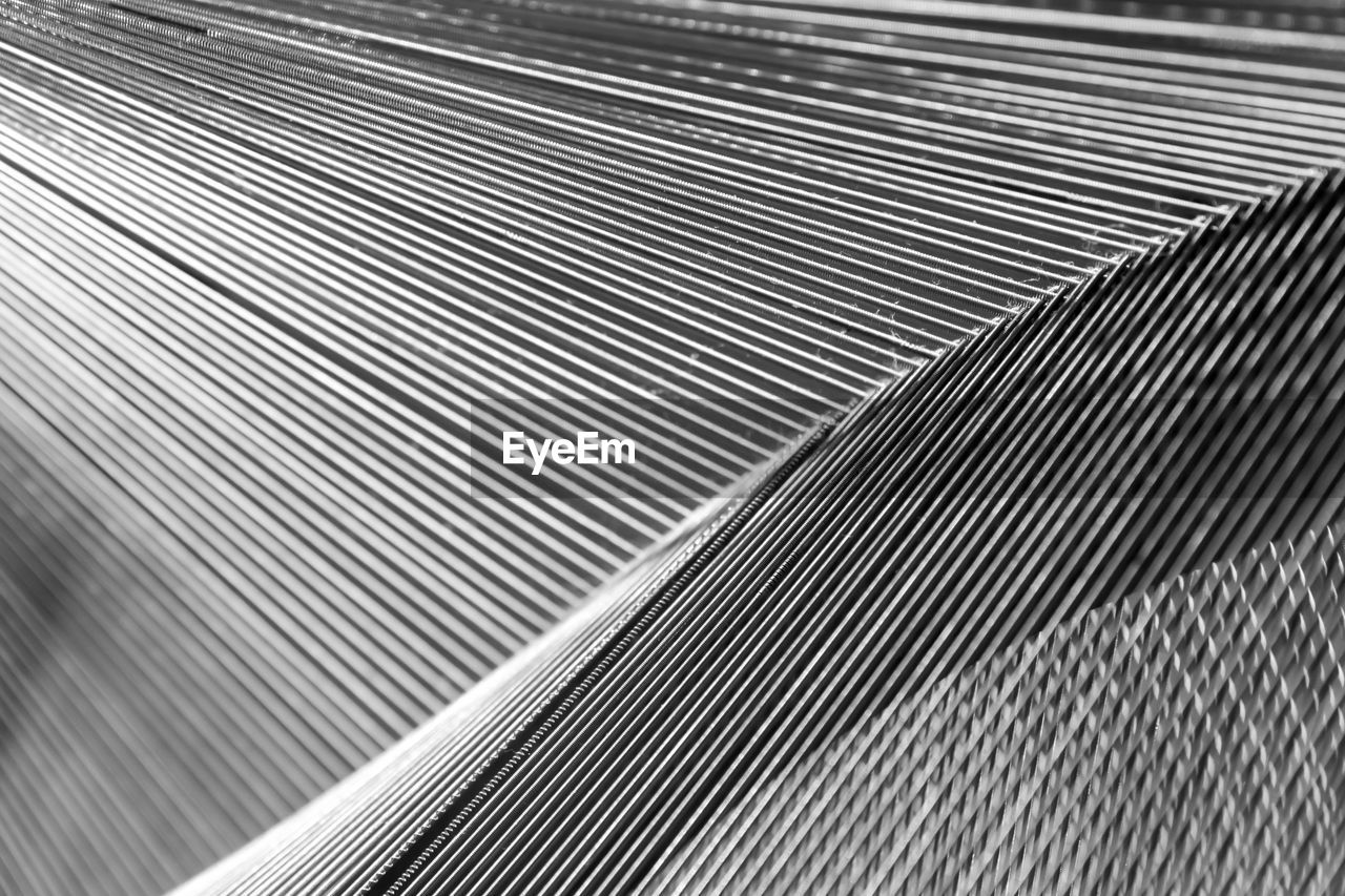 pattern, indoors, selective focus, close-up, textured, no people, modern, loom, factory, day, fanned out