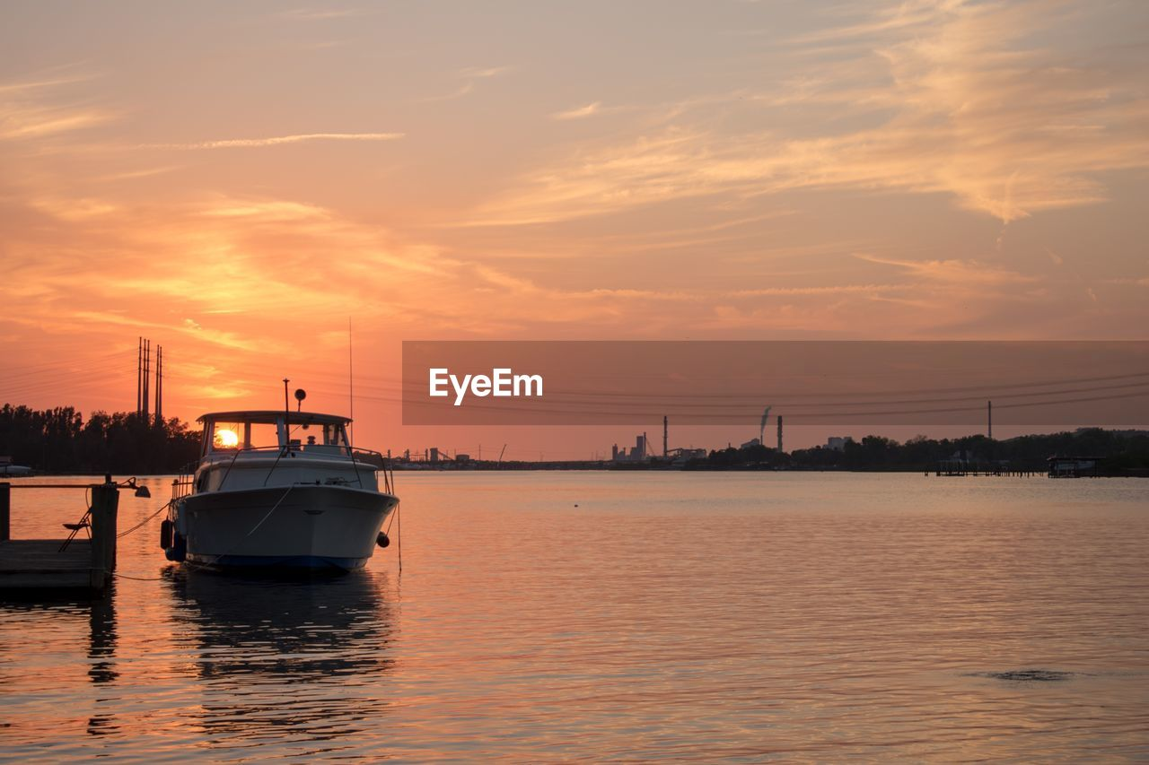 sky, nautical vessel, water, sunset, transportation, mode of transportation, cloud - sky, waterfront, sea, nature, orange color, beauty in nature, no people, scenics - nature, ship, outdoors, reflection, tranquility, tranquil scene, passenger craft, cruise ship