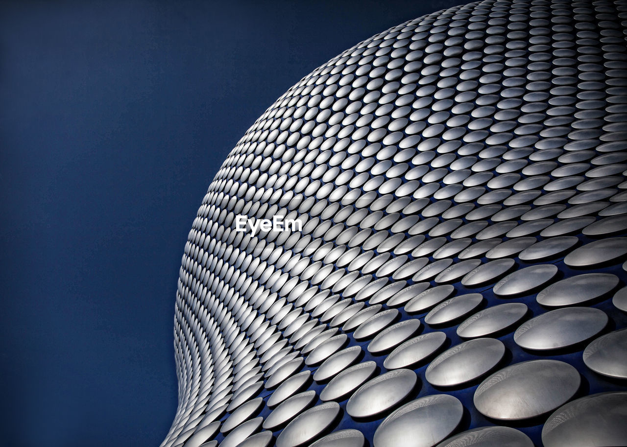 pattern, built structure, low angle view, architecture, modern, no people, design, sky, shape, blue, building exterior, metal, geometric shape, close-up, sphere, repetition, circle, nature, curve, technology, silver colored, steel, alloy