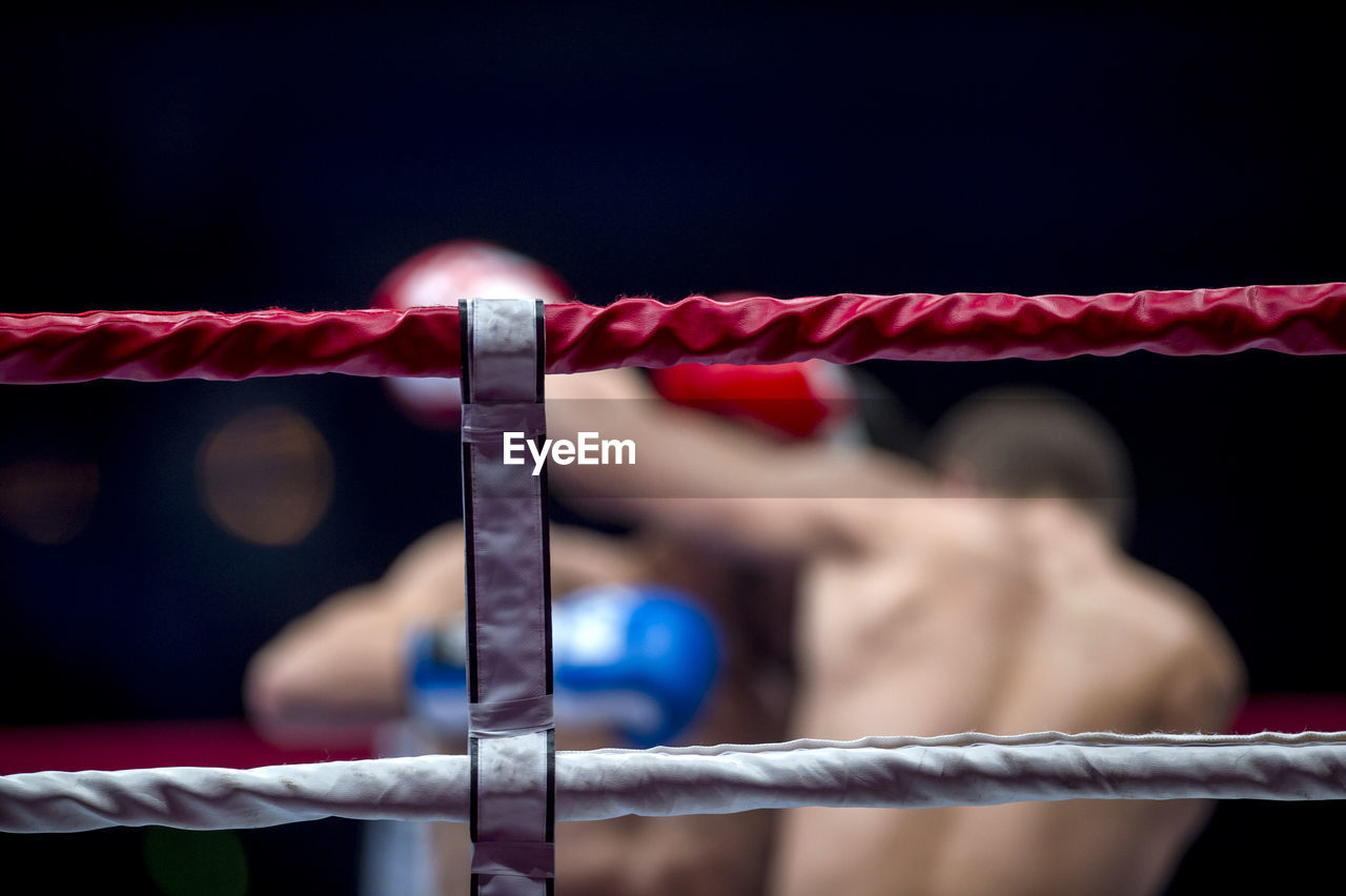 Boxers Fighting In Boxing Ring At Stadium