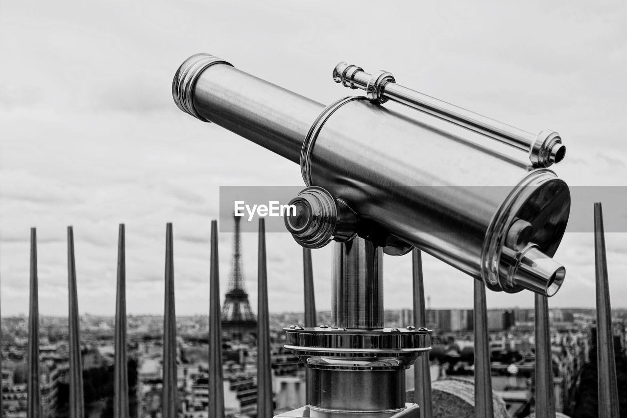 Telescope In City Against Sky