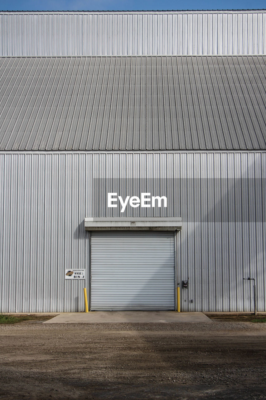 Industrial Building On Field Against Sky